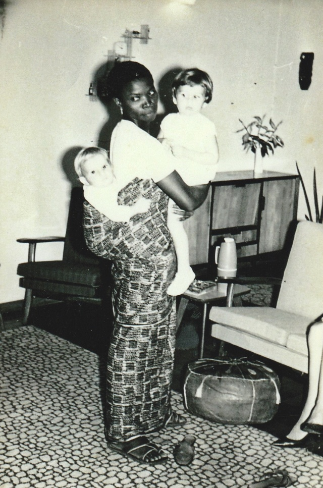 Christina Hoag being carried. LeavingLagosFeb1966 with Clara