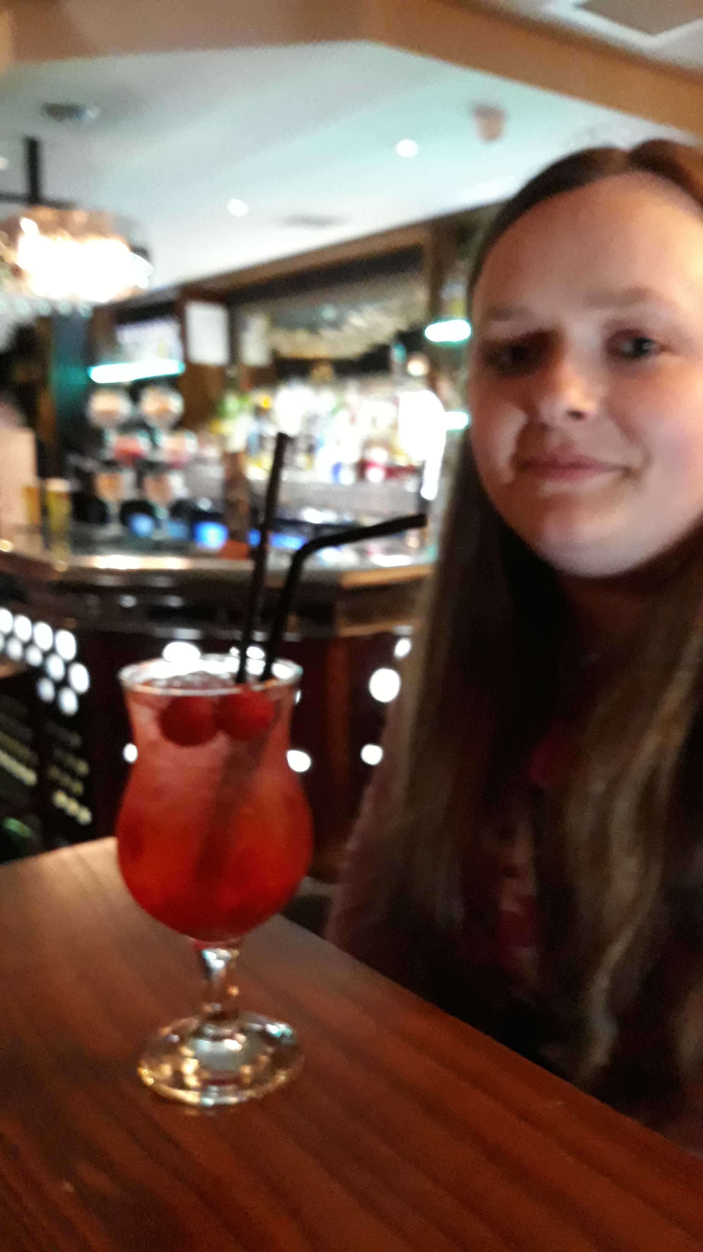 Picture of Sarah with a cocktail